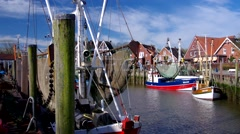 Neuharlingersiel in northern Germany, the old harbour Stock Footage
