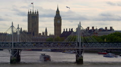 Train on Hungerford Bridge and Westminster Stock Footage