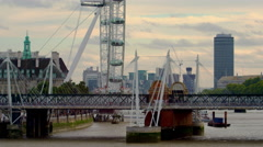 London Eye, Hungerford Bridge and Westminster panorama Stock Footage