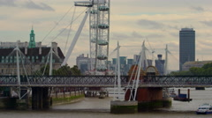 Hungerford Bridge panorama with London Eye, Westminster and Big Ben Stock Footage