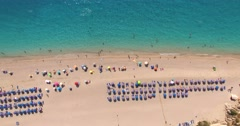 Aerial view of people enjoying on the Greek Lefkada sandy beach Stock Footage