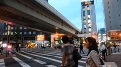 People walk at crosswalk go to travel at Dotonbori at night time in Osaka, Japan Stock Footage