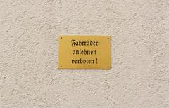 German sign forbids leaning of bikes against the wall Stock Photos