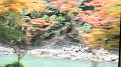 View of Hozugawa River from Sagano Scenic Railway in Arashiyama, Japan Stock Footage