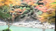 View of Hozugawa River from Sagano Scenic Railway in Arashiyama, Japan Stock Footage