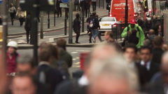 People, cyclists and traffic on a busy street Stock Footage