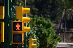 Stock Photo of yellow traffic light is red in the city