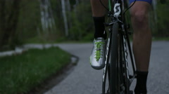 Close up of mans legs while road biking Stock Footage