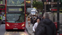Double-decker and cyclists on a busy street Stock Footage