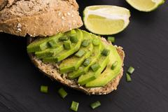 Sandwich with avocado - stock photo