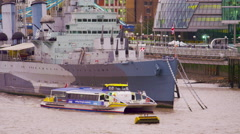Boat passing a ship on river Thames Stock Footage