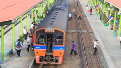 People traveling  by trains in railways station Stock Footage