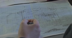 Hand With Pen Architectural Sketches Drawings Designs Schematic Drawn On Paper - stock footage