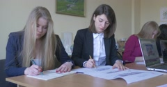 Girls Write And Draw Students Of The Faculty Of Architecture In The Classroom - stock footage
