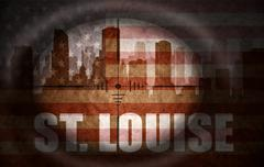 Stock Illustration of sniper scope aimed at the abstract silhouette of the city with text St. Louis