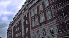 Buildings against a cloudy sky in London, England. Stock Footage