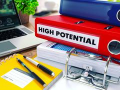 High Potential on Red Ring Binder. Blurred, Toned Image Stock Illustration