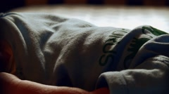 Close up video of infant baby laying in Crib taking a nap Stock Footage