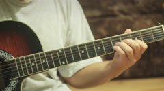 Man playing on acoustic guitar. Filmed with slider - stock footage