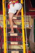 Ritual knife in the stairways Vegetarian Festival Phuket - stock photo