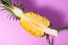 Pineapple with slices on pink background Stock Photos