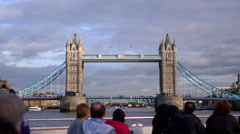 LONDON - OCTOBER 11: Unidentified tourists on ship take pictures of Tower Bridge Stock Footage
