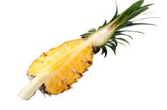 Pineapple with slices on white background Stock Photos