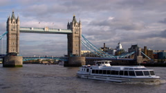 Panning view of ship and Tower Bridge in London, England. Stock Footage