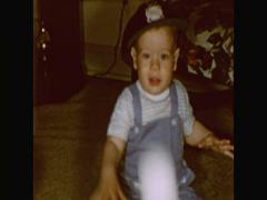 Baby boy in baseball cap throws baseball Stock Footage