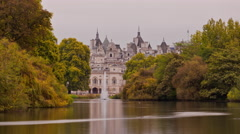 London Eye time-lapse from Saint James Park in London Stock Footage
