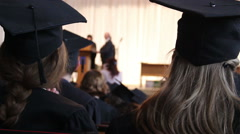 Student receiving higher education certificate from dean, graduation ceremony Stock Footage