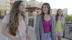 Group Of Teenage Girls Walk Around Upper Level Of Beautiful Outdoor Mall (4K) Stock Footage