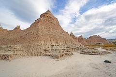 Badlands Escarpments Against Changing Skies - stock photo