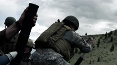 Slow motion shot of two mortar teams. The one in back firing. - stock footage