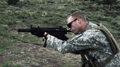 Soldier shooting automatic carbine. Stock Footage