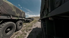 Time-lapse filmed between military convoy trucks. - stock footage