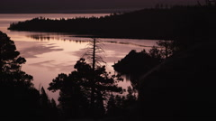 Static shot of a Emerald Bay, Lake Tahoe, California at sunset with silhouetted Stock Footage