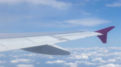 Airplane window view to the blue sky and clouds. Transportation Stock Footage