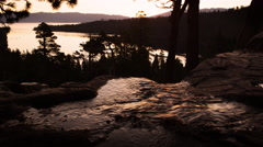 Silhouette shot of a running stream shot at sunset near Lake Tahoe. Stock Footage