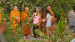 Thai people give food offerings to Buddhist monk. Stock Footage
