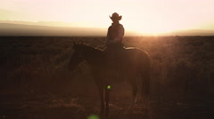 Static shot of a cowboy sitting on a horse Stock Footage