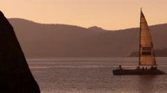 Static shot of sailboat at dusk. Shot at Emerald Bay State Park, Lake Tahoe, Stock Footage