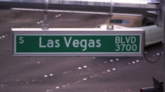 Static shot of Las Vegas street sign with cars passing through. - stock footage