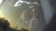 Teen Girls Take Photos Inside Car, Beautiful Reflection Of Sunset In Window (4K) Stock Footage