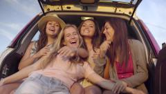 Girls Motion For Their Friend To Join, She Gives Them Hug, And They Take Selfies Stock Footage