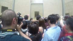 Crowd talking pics of the Mona Lisa Arkistovideo