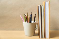 Stock Photo of stand up book with color pencil