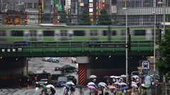 View of chaotic area in Shinjuku district on a rainy day, Tokyo, Japan Stock Footage