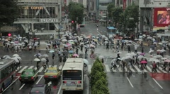 Crowd walking under the rain at Shibuya scramble crossing, Tokyo, Japan Stock Footage