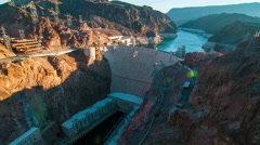 Timelapse aerial shot of Hoover Dam with lens flare Stock Footage